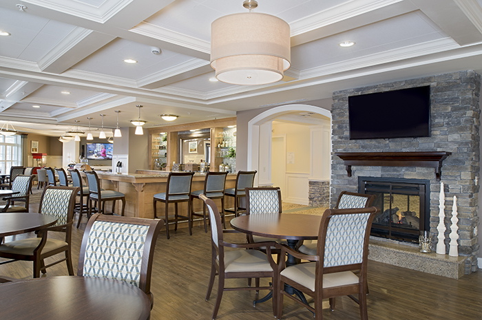 Brightview Arlington Dining Room with Fireplace - Massachusetts Senior Living