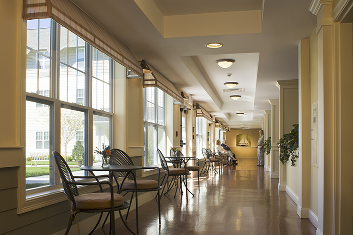 Brightview Commons Hallway with Seating Area - Rhode Island Senior Living