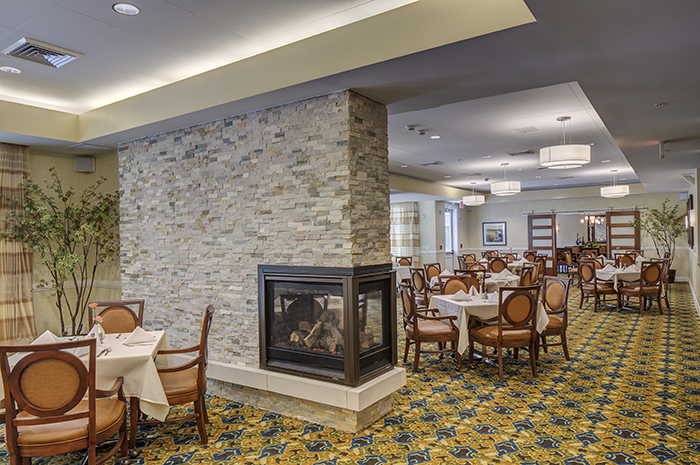 Brightview Woodburn Dining Room Fireplace - Virginia Senior Living