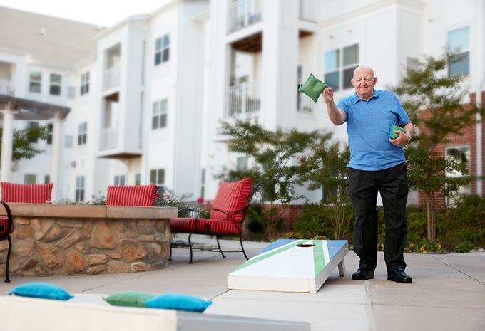 Brightview Senior Living Resident Playing Cornhole