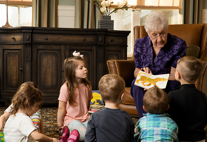 Brightview Senior Living Resident Reading to Grandchildren