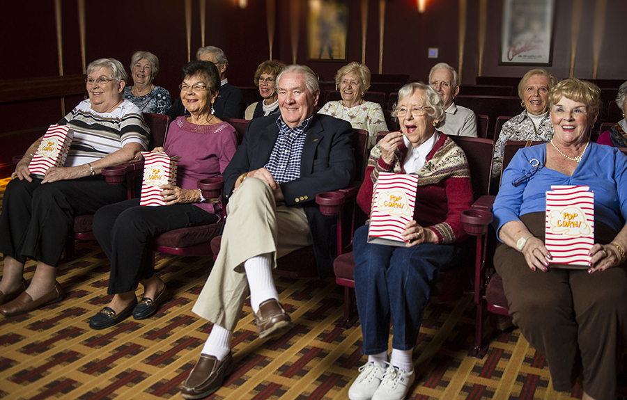 Residents enjoy the community movie theatre and popcorn