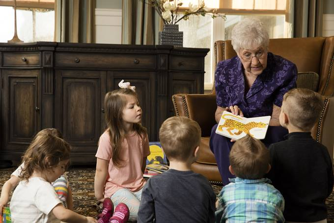 woman reading to kids